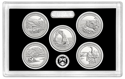 Lens and silver coins of the 2014 America the Beautiful Quarters Silver Proof Set
